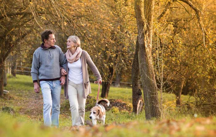 Golden Years Breaks couple walking with dog